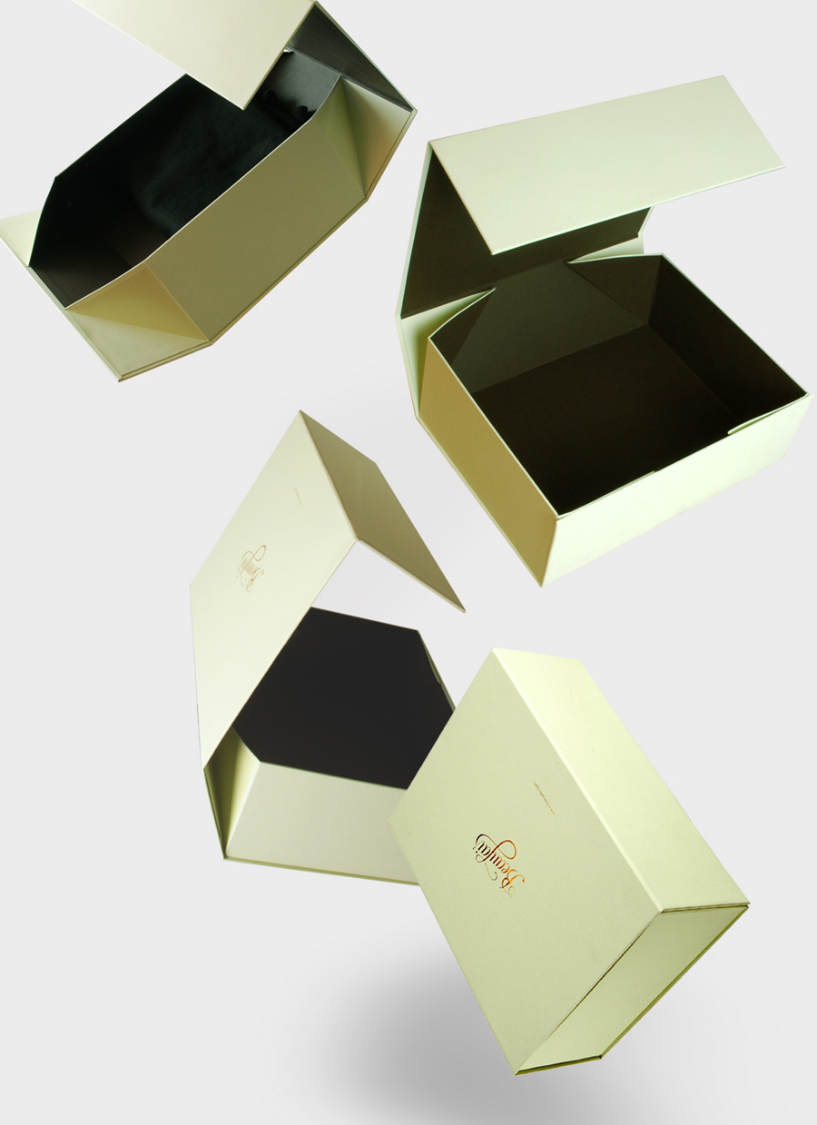 Packaging with gold foil print finish and mint paper designed by Parent for luxury lingerie brand Beaujais