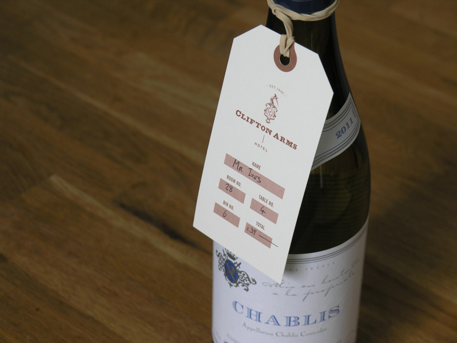 Wine tag with copper ink print treatment designed by Wash for the Clifton Arms Hotel