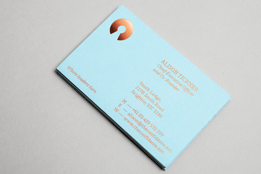 Logo and blue copper foiled business card designed by Re for executive coaching and mentoring service The Confidante