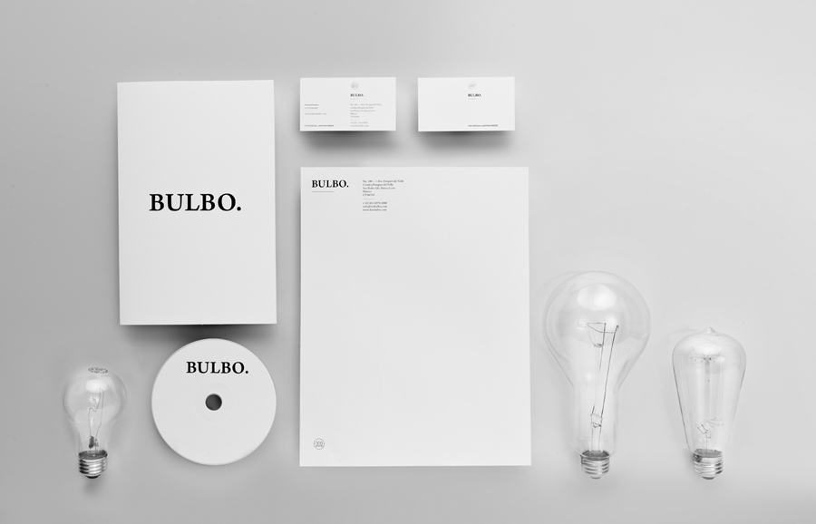 Logo and stationery with silver foil detail for high-end boutique lighting shop and interior planning service Bulbo designed by Anagrama