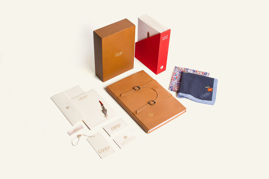 Logotype, stationery and tan leather packaging for footwear and fashion brand Candela designed by RoAndCo