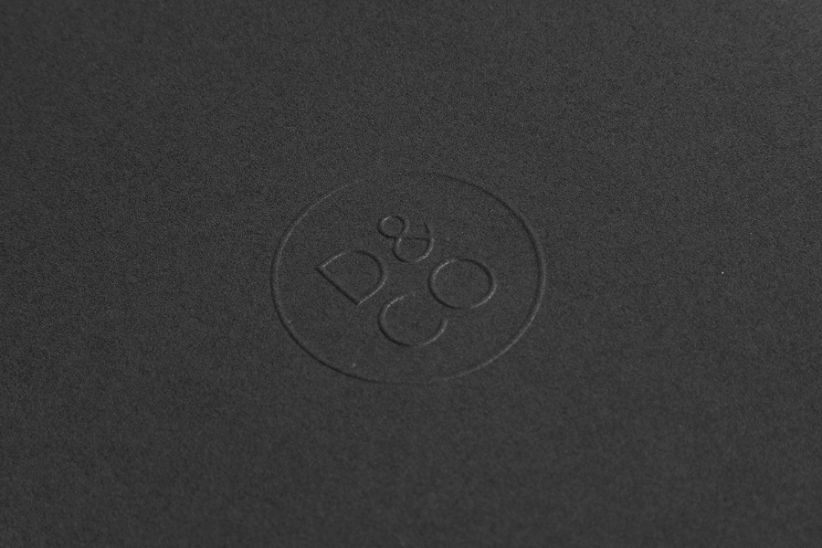Logo and a blind embossed detail designed by Hunt Studio for business advisory and management consultancy Daum & Co