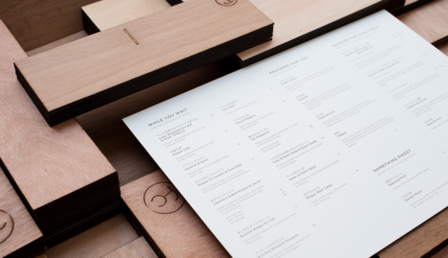 Logo and wooden menu with heat stamp treatment for specialist beef restaurant Fat Cow designed by Foreign Policy