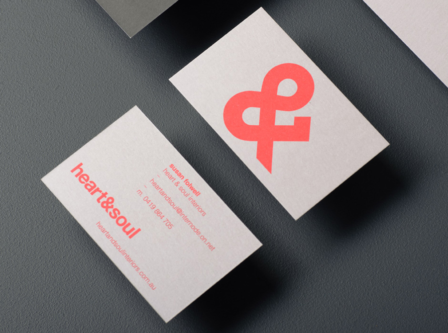 Logo and business card with neon ink and unbleached board detail designed by Band for interior decoration firm Heart & Soul