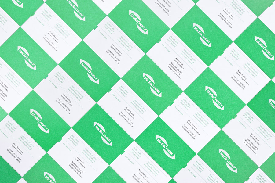 Logo and business card with fluorescent green paper and white ink combination designed by Lundgren+Lindqvist for Swedish print production and project management company MediaCreator