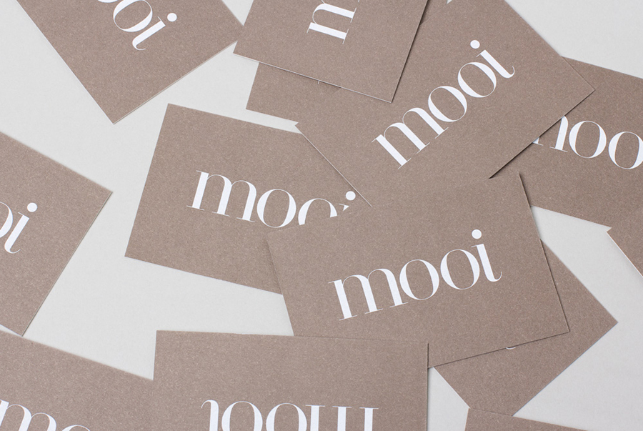 Logo and business card with a white screen printed ink and 100% cotton board designed by Morse Studio for fashion boutique Mooi