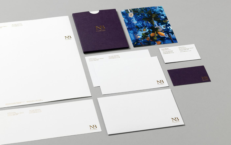 Logo and stationery design for florist NB Flowers by Karoshi
