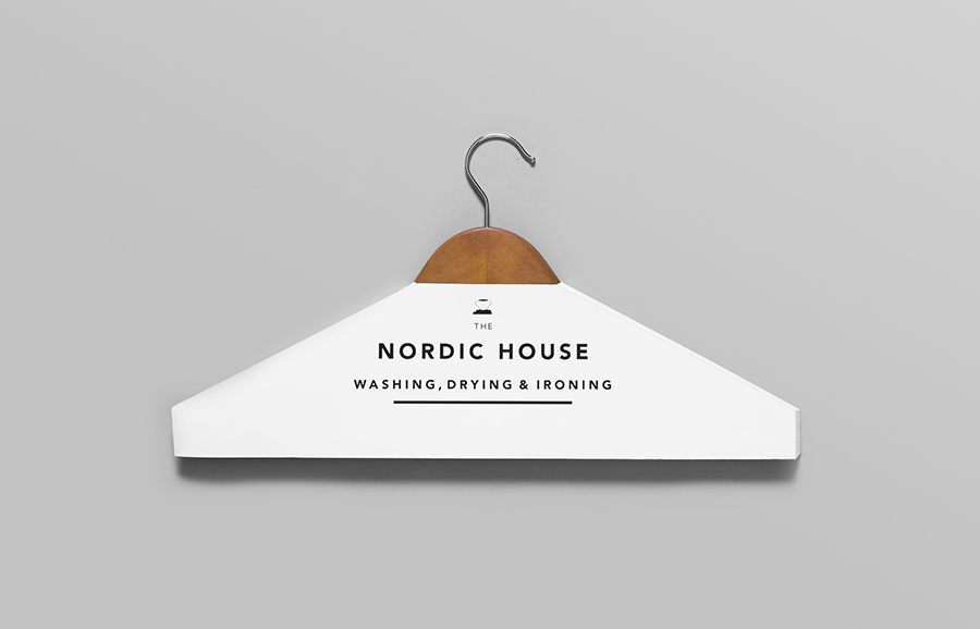 Logotype and clothes hanger cover designed by Anagrama for dry cleaning shop Nordic House