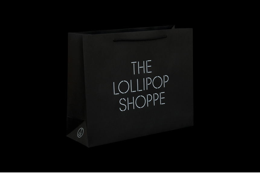 Logo and bag with white foil detail created by Studio Makgill for designer furniture and accessories retailer The Lollipop Shoppe