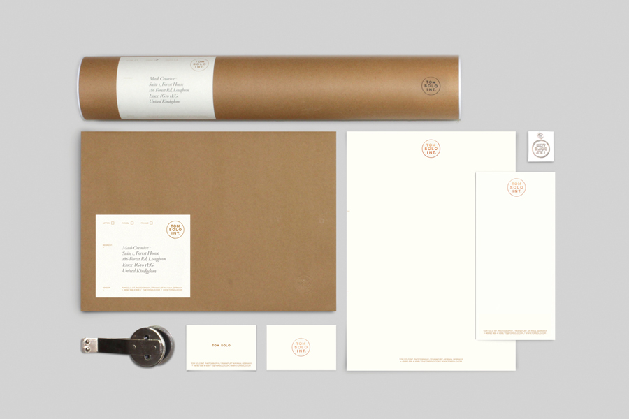 Logo and stationery with copper foil print finish for photographer Tom Solo designed by Mash