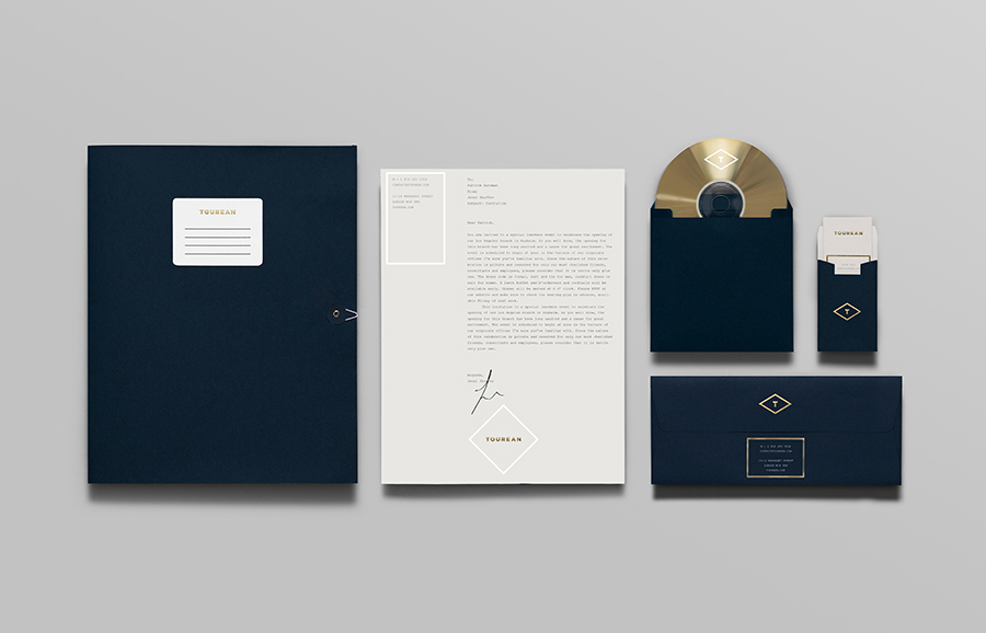 Logo and stationery with blind emboss, silver and gold foil detail designed for British multinational venture capital firm Tourean by Anagrama