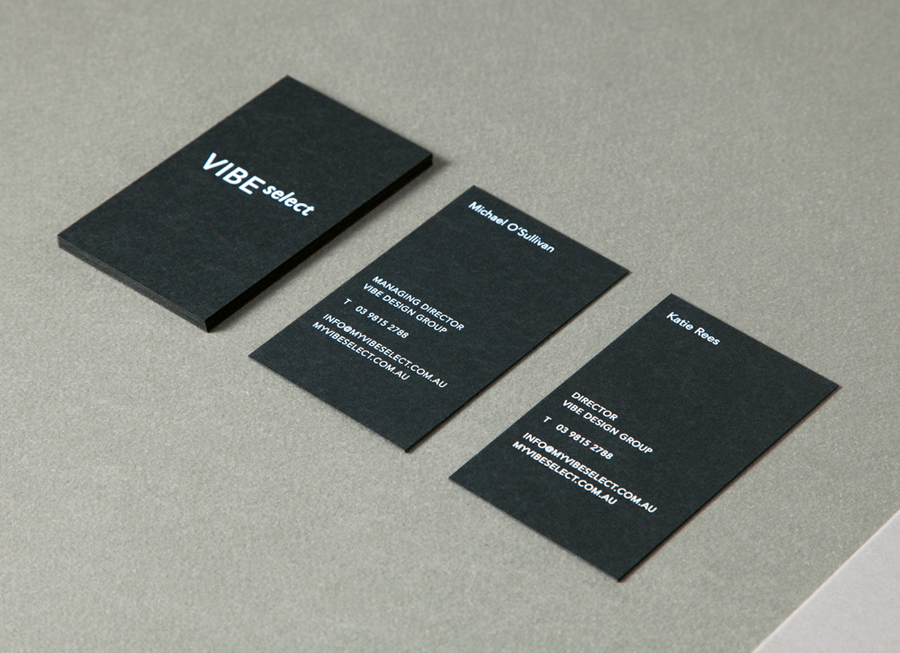 Sans-serif logotype and black board business card with white screen-printed detail for architectural firm Vibe Select designed by Studio Constantine.
