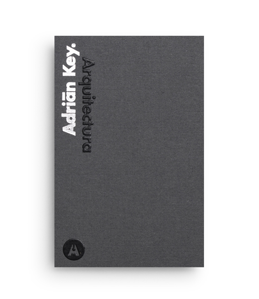 Logo and duplex business card with thermographic ink and silver foil detail designed by Face Creative for MX architecture firm and architect Adrián Key