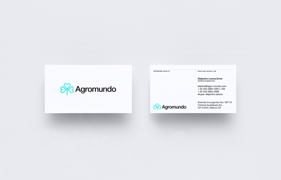 Logo and business card with neon turquoise ink detail for pesticide retailer and manufacturer Argromundo designed by Anagrama