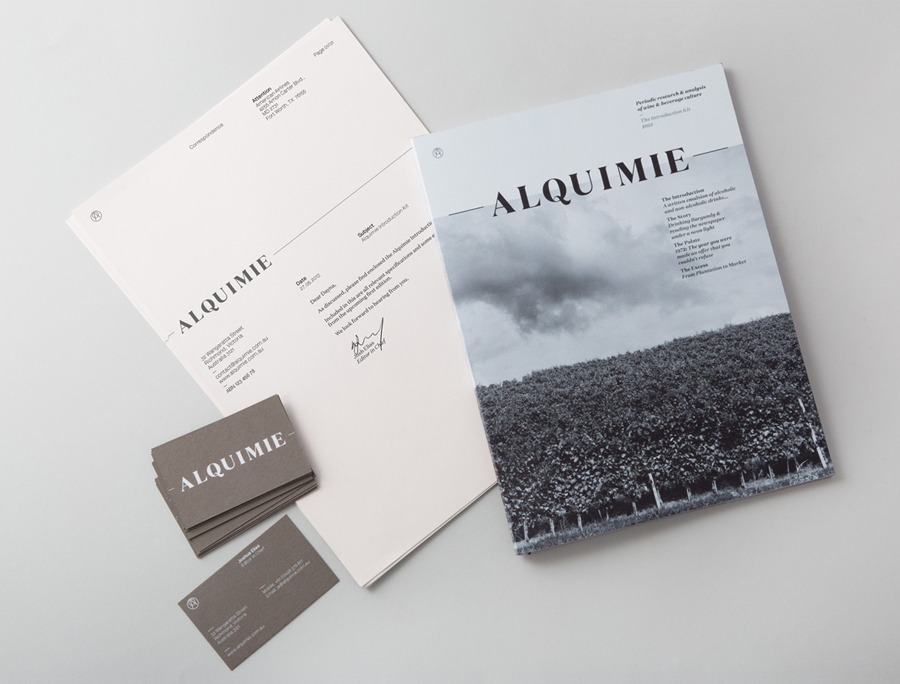 Logotype, print and white ink, warm grey business card designed by ThoughtAssembly for quarterly beverage magazine Alquimie