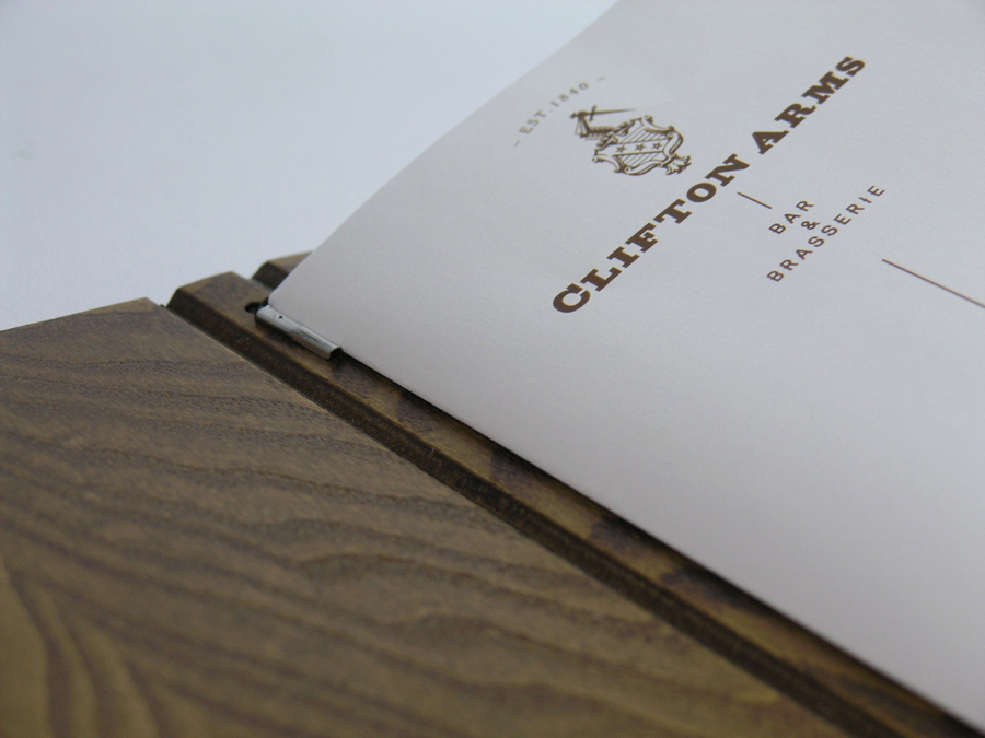 Wooden menu cover and interior pages with copper ink print treatment designed by Wash for the Clifton Arms Hotel