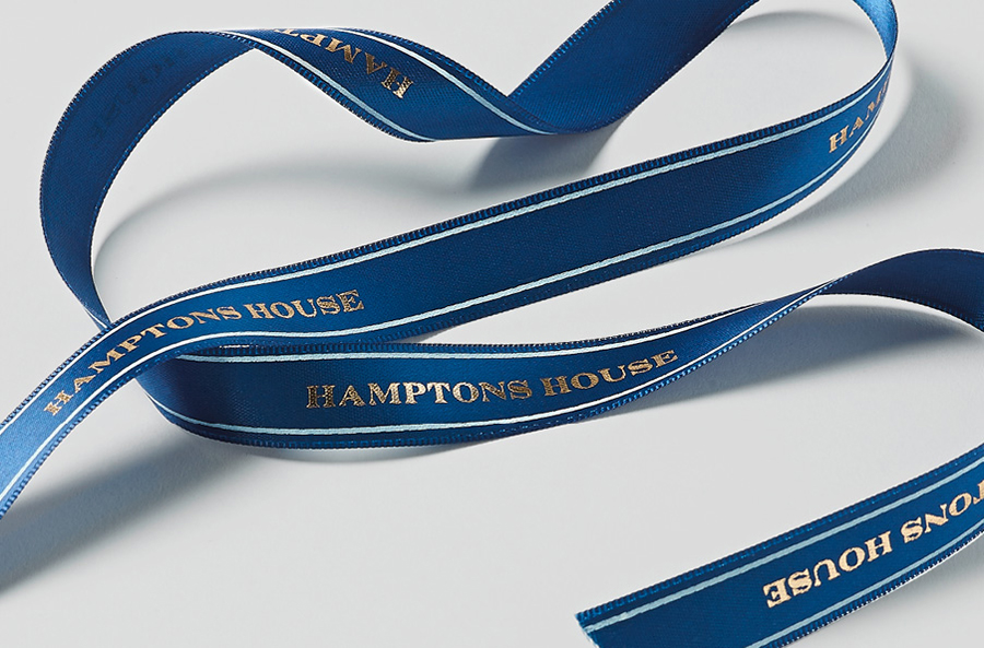Logo and ribbon with gold detail designed by Moffitt.Moffitt for Sydney furniture and homeware retailer Hamptons House