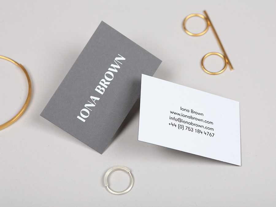 Logotype and business card with white foil detail for contemporary jewellery designer Iona Brown