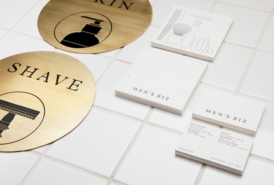 Logotype, letterpress business cards and acid-etched brass signage by ThoughtAssembly for male grooming business Men's Biz