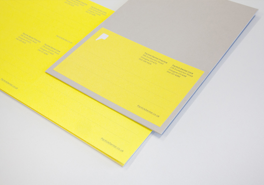 Logo and stationery with yellow paper detail designed by Freytag Anderson for Partick Dental featured on BPO