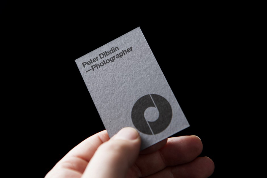 New brand identity for peter dibdin by o street bpo monogram logotype and grey board business card designed by o street for photographer peter dibdin reheart