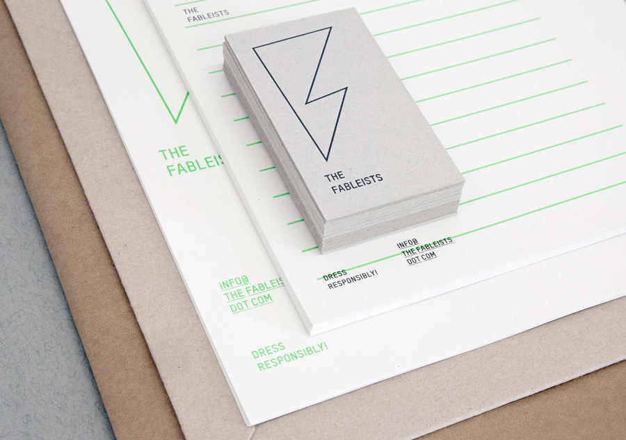 Logo and uncoated, unbleached stationery with fluorescent green ink print finish for children's fashion brand The Fableists designed by Freytag Anderson featured on BPO
