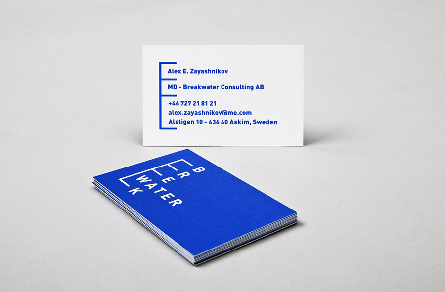 Logo and business card with bright blue spot ink treatment for Swedish marine cargo logistics company Breakwater designed by Lundgren+Lindqvist