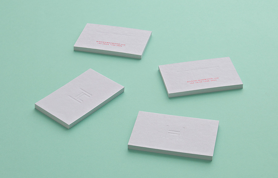 Logo and blind deboss business cards designed by Two Times Elliott for Daniel Hopwood