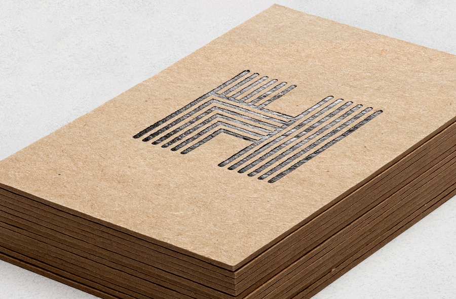 Logo as a black foil detail across an unbleached business cards design by Spy for architecture firm Haverstock