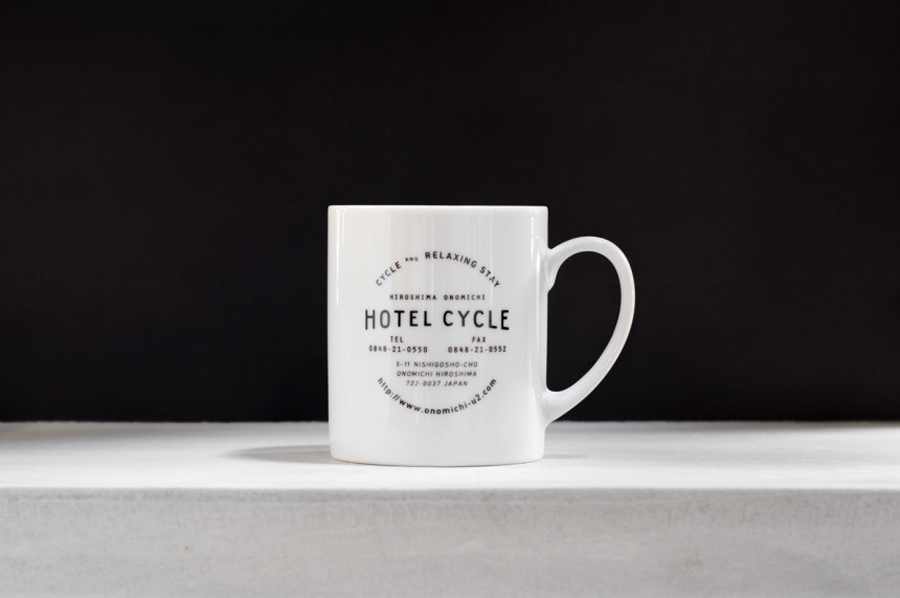 Logotype and mug designed by UMA for U2's Onomichi based Hotel Cycle