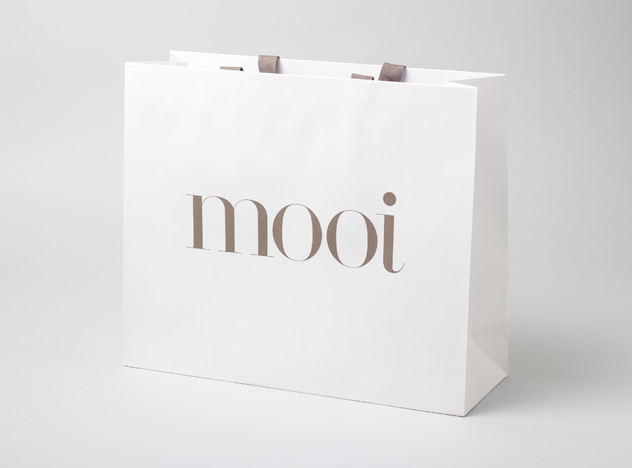 Logo and paper shopping bag designed by Morse Studio for fashion boutique Mooi