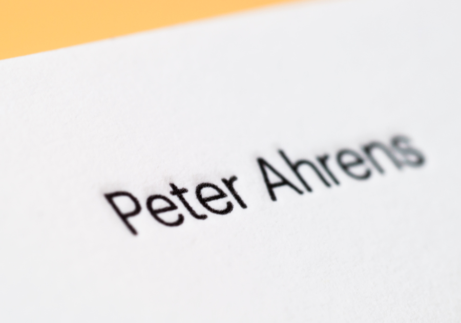Logotype and letterpress business cards for photographer Peter Ahrens by Studio Jubilee