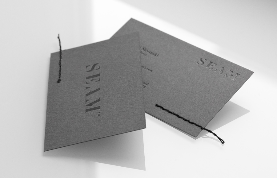 Logo and business card with black block foil and hand-sewn detail designed by For Brands for fashion brand Seam