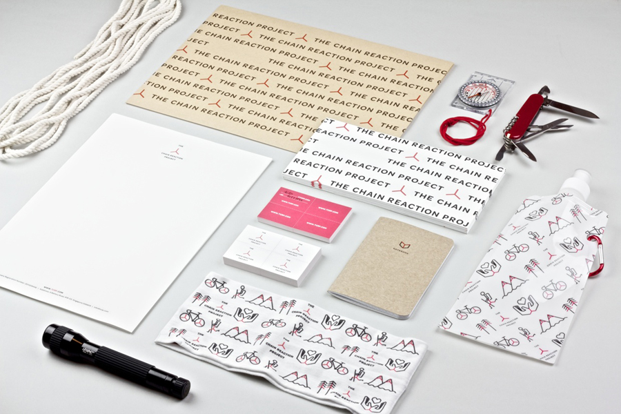 Logo and stationery with iconography detail for The Chain Reaction Project designed by Bravo Company