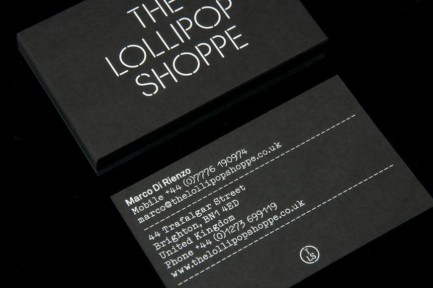 Logo and business cards with white foil detail created by Studio Makgill for designer furniture and accessories retailer The Lollipop Shoppe