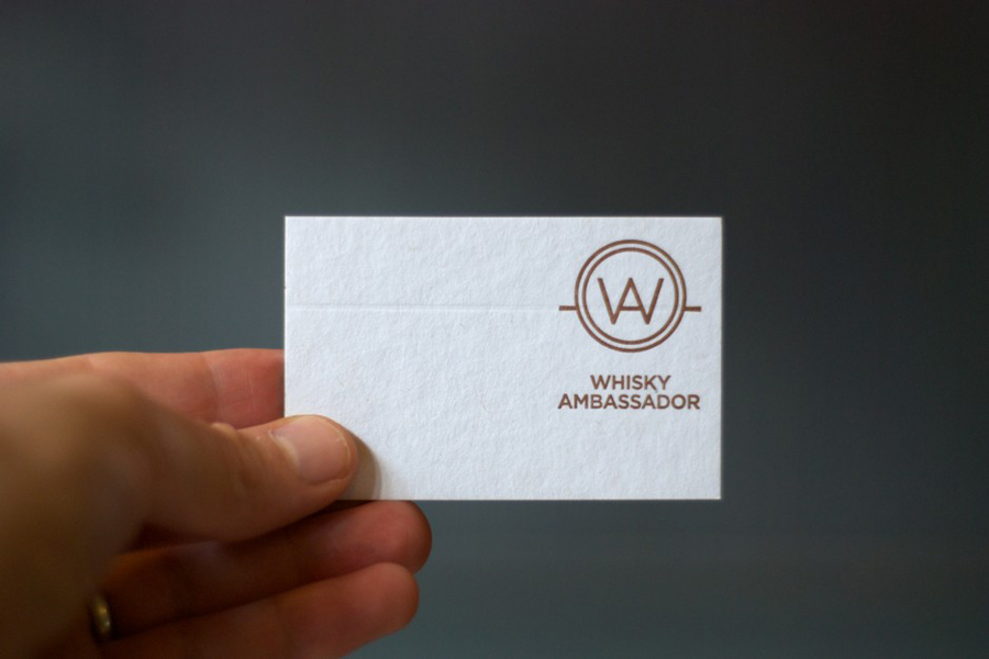 Logo and business card with copper print detail designed by O Street for Whisky Ambassador