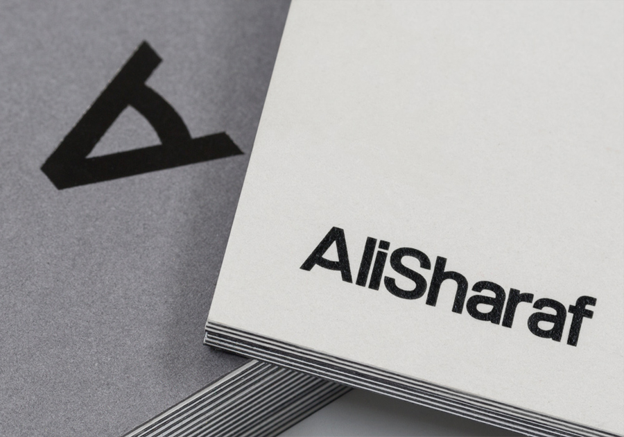 Logo and duplex business card with black foil detail designed by Mash for photographer Ali Sharaf