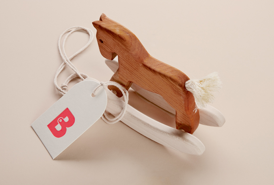 Logo and debossed tag designed by The Company You Keep for curated mum-to-be hospital bag service Bundle