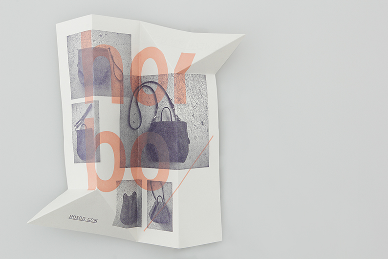 Logo and print with a distinctive folded angle detail designed by Blok for luxury bag, clothing and accessories brand Hoi Bo