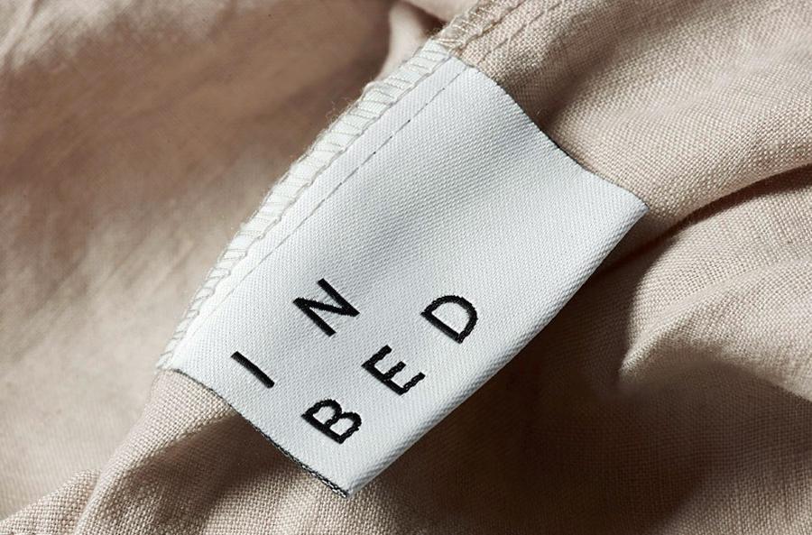 Logo and label for online linen retailer In Bed designed by Moffitt.Moffitt