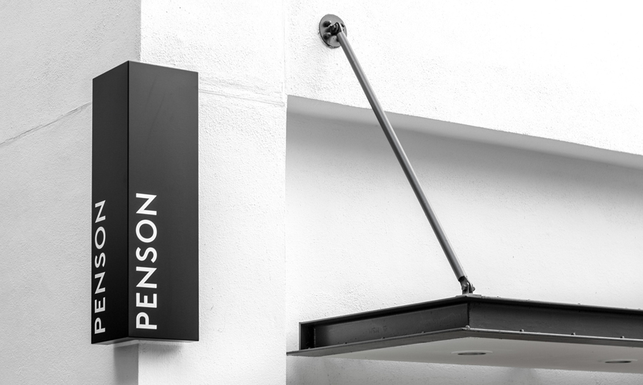 Logotype and exterior signage for interior design firm Penson Group created by She Was Only