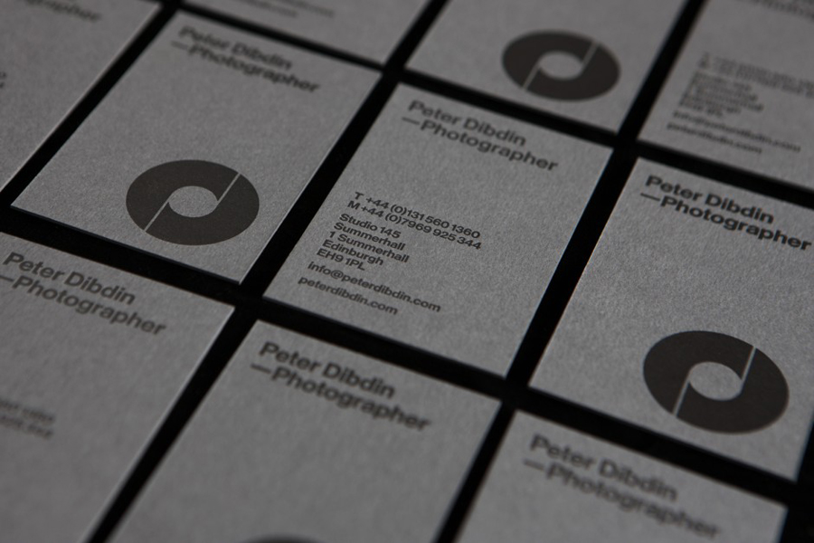 Monogram, logotype and grey board business card designed by O Street for photographer Peter Dibdin