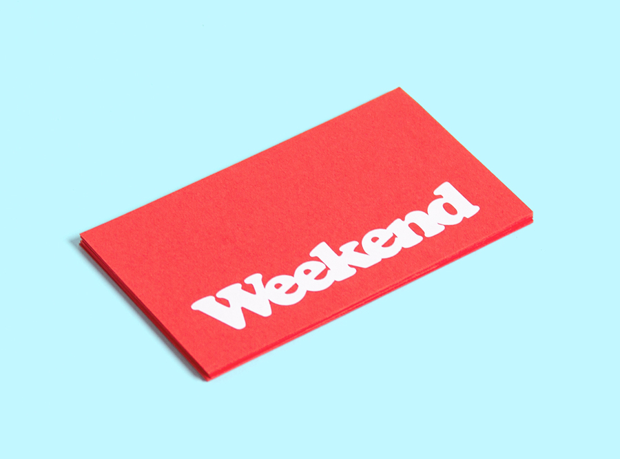 Logo and business card with a red board and white ink detail designed by RoAndCo for Dallas coffee shop Weekend