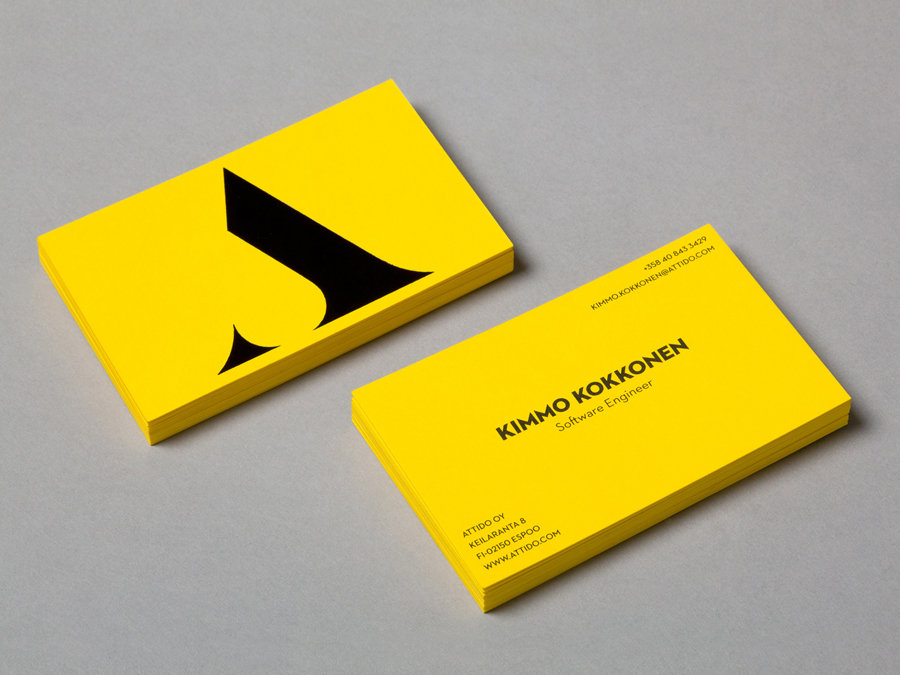 Logo and business card with a yellow board and black ink colour palette designed by Bond for Finnish information system development and optimisation company Attido