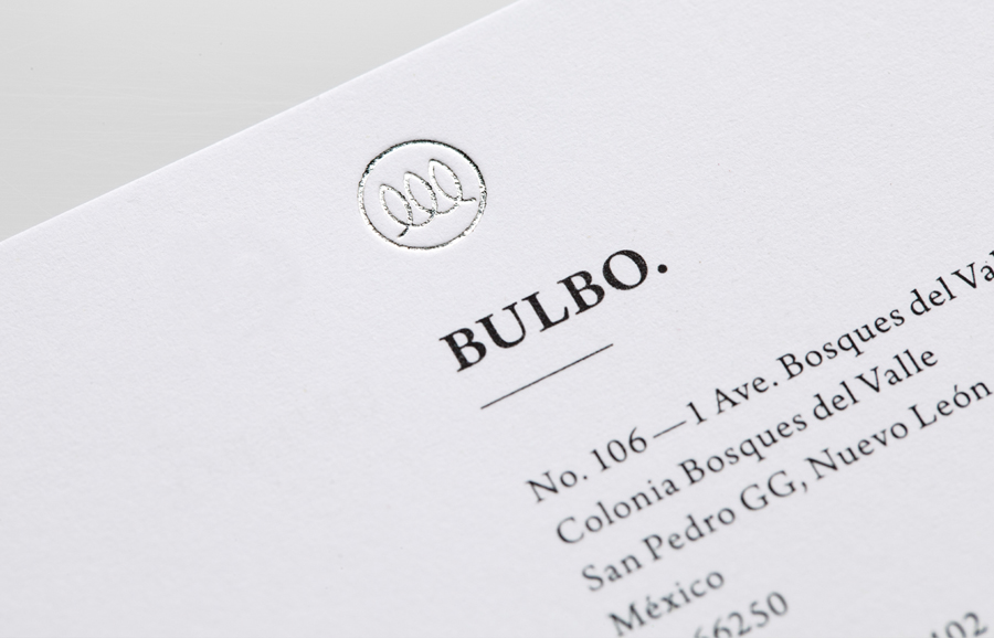 Logo and business card with silver foil detail for high-end boutique lighting shop and interior planning service Bulbo designed by Anagrama