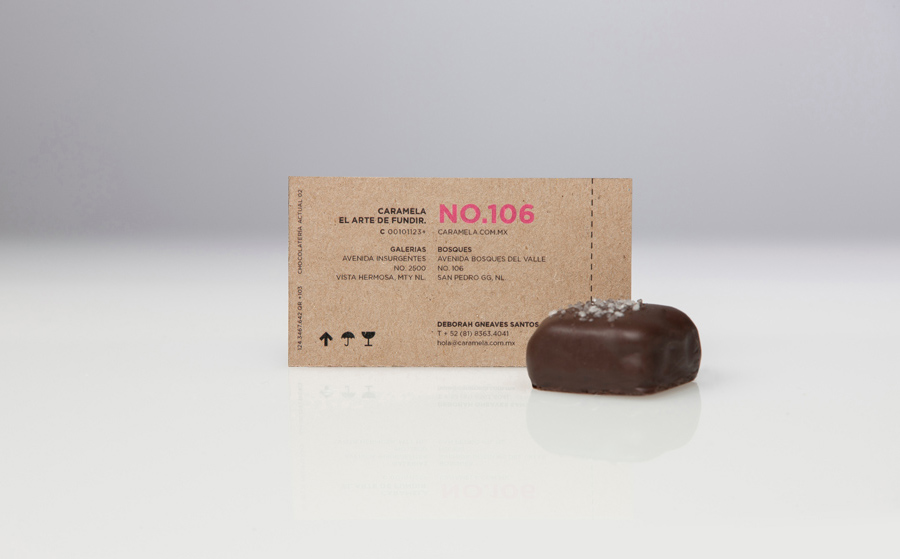 Business card with pink neon ink across an unbleached substrate designed by Anagrama for chocolate boutique and caterer Caramela