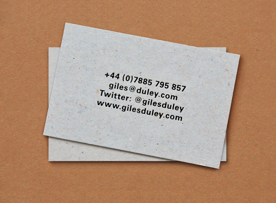 Business card with black foil deboss detail for photographer Giles Duley designed by Shaz Madani