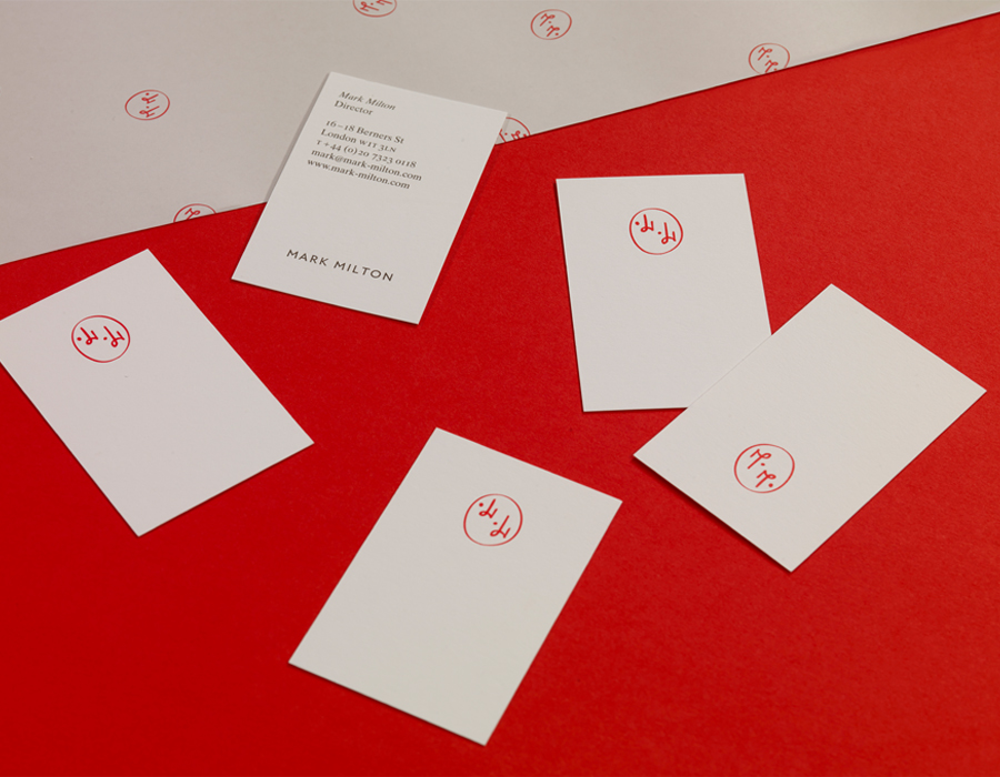 Logo and business cards with a red spot colour detail designed by ico for jewellery brand Mark Milton