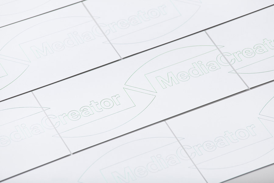 Logo and correspondence cards with green fluorescent ink detail designed by Lundgren+Lindqvist for Swedish print production and project management company MediaCreator