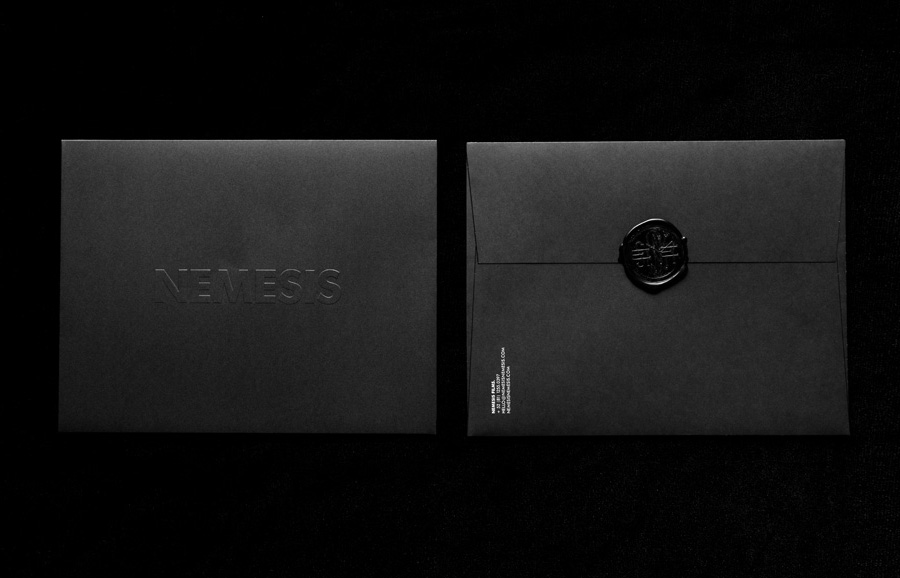 Logo and envelope with a wax seal and blind embossed detail designed by Anagrama for Latin American horror film production company Nemesis Films